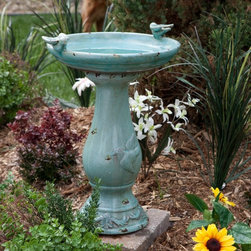 Alpine - Alpine Antique Light Turquoise Ceramic Bird Bath with 2 Birds Multicolor - TLR10 - Shop for Garden Bird Baths from Hayneedle.com! Bring a beautiful and classic touch to your yard with the Antique Light Turquoise Ceramic Bird Bath. Handcrafted out of ceramic and finished in an antique light turquoise glaze you'll love the way this bird bath takes you back to the Victorian age. Decorated with a bird perched on each side of the bowl you'll enjoy watching colorful birds come to bathe and drink.About Alpine CorporationAlpine Corporation has offices in Arizona Colorado Florida Iowa and Ohio. With a firm belief in the free enterprise system Alpine Corporation promotes equal treatment for customers employees shareholders suppliers and the community. Alpine Corporation carries a vast array of items including fountains pond and garden accessories and statuary and carries lighting and parts as well. A steadfast goal for Alpine Corporation is to continually exceed their customers' increasing expectations.
