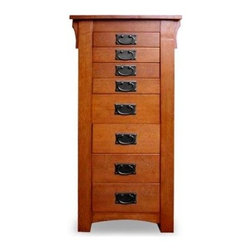 Powell Mission Oak Jewelry Armoire - What We Like About This Jewelry ArmoireThe perfect addition to your bedroom set this handsome jewelry armoire has plenty of storage room for all of your valuable possessions. It features four large drawers and four small drawers with ovular metal drawer pulls. The sides swing open to reveal a lined interior with hooks for your delicate necklaces and beads. The simple top is mirrored on the under side and covers a neatly compartmentalized area for rings bracelets and other dainty items.Individual drawer information: The flip-top drawer is lined in black with ring pads on one half and 12 compartments for storing earrings or small items on the other. The first drawer includes 12 compartments for small items. The second drawer includes nine squares for jewelry sets or larger items. The third and fourth drawers include six compartments for organizing larger items. The fifth through eighth drawers have open compartments for all-purpose storage.Please click on image to enlarge and view additional photos.