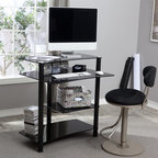RTA Home and Office - Black Glass Mini Computer Desk - CT-010B - Shop for Desks from Hayneedle.com! Advertise your technological savvy with the RTA Home and Office Black Glass Computer Desk. Made of thick black tempered glass shelves supported by round aluminum tubes this compact desk has a decidedly modern style. Each component of your computer has its own special shelf. The monitor perches on top with a deeper keyboard tray below. Underneath is a convenient place for your CPU and another shelf for your printer; everything is neatly tucked away but still easily accessible. The glass shelves have a curve to them so you will have plenty of room to scoot your chair up and get to work comfortably. This desk is easy to assemble and backed by a one-year limited warranty.About RTA Home and OfficeIf you've decided to outfit your home or office with sleek modern style look no further than the RTA Home and Office product line. Based in Springfield Missouri RTA Home and Office Inc. was founded in 2001 and specializes in the manufacturing and distribution of high-quality tempered glass and polished aluminum TV stands desks and tables. All of the tempered glass shelves table tops and desk tops have smooth rounded edges for safety. Incredibly strong and durable these strikingly contemporary pieces will add high-tech style and design to a variety of home settings.