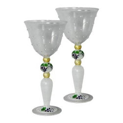 Grapes 'n Vines Wine with Raised Dots Glasses  Set of 2 - This is a mouth blown wine glass that has raised glass features pretty grapes and vines.  Perfect for the holidays or any season.  Something to be handed down from generation to generation. Proudly hand painted in the USA.