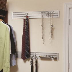 Closet Accessories - Slatwall added to a wall in your closet is a great place to hang ties or belts or organize your jewelry.