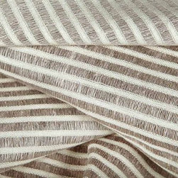 Striscia Sheer Stripe Drapery Fabric in Mystic White - Striscia Sheer Stripe Drapery Fabric in Mystic White is a neutral drapery fabric with a small scale stripe pattern. Ideal for window treatments or canopies, this contemporary fabric has a great quality and price! Made from a blend of 80% linen and 20% cotton. Passes 3,000 double rubs. Cleaning code: S. Width: 59″