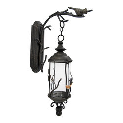 Zeckos - Birds and Branches Decorative Wall Mounted Hanging Lantern - This wall mounted lantern adds a decorative accent to your home, porch, or patio. The hanger measures 16 1/2 inches tall, 7 inches wide, 14 1/4 inches deep and mounts to the wall with a single nail or screw. The lantern is 19 1/2 inches tall, 6 inches in diameter, and hangs 3 1/2 inches from the hook on the wall bracket. The glass globe measures 8 inches tall and approximately 4 1/2 inches in diameter. This piece has a wonderful weathered, antique finish, and looks great with a flickering LED candle in it.