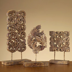 Hand Carved Wood Sculptures - Set of 3 - Tabletop ornaments with a precious rustic weathering and an incredible depth of piercework detail, these three hand-carved sculptures resemble architectural fragments of wood applique salvaged from antique furniture or a classic interior.  With one square, one rectangular, and one round carving mounted on sleek matching block pedestals, the scrollwork trio creates a breathtaking transitional landscape on your coffee table or shelf.