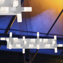 Sonneman A Way Of Light - Connetix Bath Bar - The Connetix Bath Bar features artful intersections of square elements and acrylic blocks that converge at right angles, forming compositions of geometric elements. Finished in bright satin aluminum with a shade of etched acrylic blocks. Twenty Cree XP-G 3000K 80 CRI LEDs totaling 34 watts included. Dimmable with Lutron Electronic Low Voltage dimmer, CTELV-303P, sold separately. ETL listed. 10 inches high x 29 inches wide x 5 inches deep. 4.5 inch x 24 inch canopy.