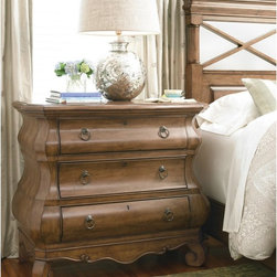 Pennsylvania House - New Lou Louie Ps 3 Drawer Chest - Cognac - 071360 - Shop for Dressers from Hayneedle.com! The undulating frame and large scroll feet of the New Lou Louie Ps 3 Drawer Chest Cognac make a bold bedroom statement of exquisite traditional detail. This bombe-style chest is designed in an updated Louis Philippe style with its rich 19th century origins complemented by modern conveniences such as a lift-lid top with discreet power outlet for cords or electronics recharging.The beautiful contours of this three-drawer chest give dramatic form to the natural beauty of solid alder wood. A lightly distressed cognac finish is complemented by antiqued bronze ring pull hardware and keyhole cutouts with decorative molding on the front and sides. Luxurious and visually striking this bedroom accent is definitive proof of the timelessness of classic furniture.About Universal Furniture InternationalRecognized as a leader in exceptionally crafted home furnishings including bedroom and dining room items entertainment centers and more Universal strives to make items that are styled to endure but always remain fresh. They make it a goal to include features that fit the way their customers live today and to find prices that put high-quality products within reach. These are the principles that guide the work at Universal essential elements of good affordable and smart design.