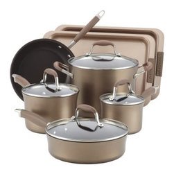 Anolon Advanced Hard Anodized Nonstick Cookware Set - Bronze - With all the craziness that goes on in a professional kitchen, when you hear that the Anolon Advanced Hard Anodized Nonstick Cookware Set - Bronze is trusted by chefs, well that really means something. This full set is crafted from hard-anodized stainless steel for quick and even heat distribution and a classic bronze finish. The silicone rubber handles are cool to the touch, and even oven-safe up to 400 degrees F. The non-stick surface covers the interior of each pan and sheet so you can serve and enjoy every bit of your cooking instead of scrubbing it off when dinner's over. Tempered glass lids let you see how things are going, and baking is only a warm oven away with a pair of non-stick baking sheets that are oven-safe up to 500 degrees F. Each piece is dishwasher-safe, so you've got no reason to not get ready to put your kitchen chops to the test.This set includes:1.5-qt. covered saucepan&#443-qt. covered saucepan&#448-qt. covered stockpot&#448-in. open skillet&#4410-in. open skillet&#443-qt. saute pan&#4412-in. shallow grill panAbout Anolon CookwareFor those who think recipes are more like suggestions, meet Anolon - a leading brand of gourmet cookware designed to empower food enthusiasts to creatively express themselves in the kitchen. Anolon gives home cooks the ability to cook outside the recipe by offering a wide selection of high-performance, exceptionally crafted cookware, bakeware, cutlery, tools and gadgets that satisfy the needs of each home chef's unique cooking style. Celebrate creativity in the kitchen with Anolon.