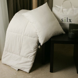 Silx Bedding - Silk-Filled Comforter with Cotton Cover - Features: -Material: Silk fibers.-260 Thread count.-100% Natural, hypoallergenic and inhospitable to dust mites.-Perfect alternative to down, cotton, wool or any other comforter filling.-Inside the comforter are long strands of mulberry silk which come from mulberry silk cocoons and are about 1,300 feet long.-Strongest natural fiber and also a natural fire retardant.-Half the weight of down and drapes to your body, eliminating cold spots.-Due to its low moisture retention, the silk-filled comforter is also mildew resistant.-Hand-stretched silk batting never wanders or bunches.-18 Essential amino acids are beneficial to the skin, hair, and joint pain.-Silk is temperate, great all year round.-Color: White.-Distressed: No.Dimensions: -Baby: 1'' H x 30'' W x 36'' D, 0.63 lbs.-Twin: 1'' H x 68'' W x 86'' D, 3.56 lbs.-Full / Queen: 1'' H x 90'' W x 86'' D, 8.86 lbs.-King: 1'' H x 104'' W x 94'' D, 9.23 lbs.