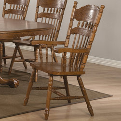 "Coaster - Brooks Arm Chair, Oak - Set of 2 - The traditional oak table features a smooth oval top, with two 18 inch center leaves so you can easily extend the length of the table from 60 inches long to 78 or 96 inches long, so you can accommodate dinner guests. A double pedestal trestle base with pretty turned spindles. Pair with any chairs from this collection for a complete dining ensemble that will fit your needs.; Country Style; Oak Finish; Dimensions: 24""L x 23.25""W x 41.25""H"