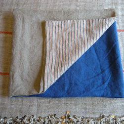 Simone Linen Beach Towel by Choisette - This handmade linen towel has a reversible pattern of blue and gray marine stripes. You're definitely paying for the handmade style, but it's a better deal when you consider that its size is substantial enough for two to share.