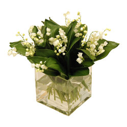 The French Bee - Lily of the Valley - The great thing about artificial flowers is they never wilt. The not-so-great thing is they often look fake. This beautiful Lily of the Valley bouquet is an exquisite exception! With pure silk blooms, you'll have to touch them to confirm they weren't just plucked from the garden. The clear glass cube vase is also filled with faux water to complete the realistic look.