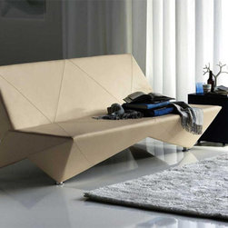 """Origami Modern Leather Sofa-Bed By Cattelan Italia - Don't worry, this sofa bed will not fold up on top of you, unlike the old one at your parents' house! Instead, its clean lines are spruced up with the """"fold marks"""" of a good piece of origami, adding a little extra wit."""