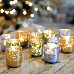 Ballard Designs - Suzanne Kasler Mercury Glass Votive Holders - Set of 6 - Adds instant sparkle to your table or mantel. Big looks at a great value. Fits standard votive or tea light. The holidays are designer Suzanne Kasler's favorite time of year. This season, she's adding shimmer and shine to her holiday collection with mercury glass. This set of six includes two of each color, all designed to mix and match with her signature wrapping papers, ribbons and ornaments.Suzanne Kasler Mercury Glass Votive features: . . .
