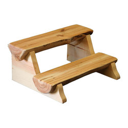 """Aspen Half Log Step Stool - Create a lodge look in your bedroom or kitchen with the gnarly and twisted look of the Aspen Half Log Step Stool for lots of rustic character. Handmade from naturally harvested solid standing dead Aspen logs. Your choice of a natural finish with clear lacquer (shown) oak stain or Early American stain. 16""""W x 15""""D x 13""""H. Finished with a protective coat of lacquer so you need only wipe it off. Any dents or marks can be minimized with the use of an oil-based furniture polish. Made in the USA. Checks and cracks are natural and will not affect the stability of the furniture."""