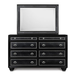 Magnussen Furniture - Onyx Drawer Dresser with Landscape Mirror - Constructed from select hardwood, PVC, Metal caps and shiney chrome nails. Tinted drawers with English dovetail in the front and the back. Felt lined top drawer and sealed for dustproofing. Drawer Dresser Features 8 drawers. Mirror features 1in. bevel. Select Hardwoods, PVC, Shiny Chrome Nails, Metal Caps and Chrome Hardware. Black Finish. 1 Year Limited Warranty. Dresser & Mirror: 64 in. W x 19 in. D x 77 in. H (198 lbs.). Dresser: 65 in. W x 19 in. D x 41 in. H. Mirror: 49 in. W x 1 in. D x 36 in. HInfuse your world with high-end style through our Onyx collection. Inspired by the pages of international fashion magazines, this couture-worthy collection turns even the dullest architectural space into a showpiece of designer decor. With crocodile PVC, chrome plated nail heads, crystal hardware and sumptuous, high gloss black finish.