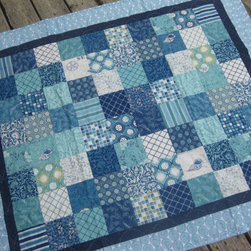 'Seascapes' Nautical Quilt by Olive Street Studio - Quilts are perfect for the beach! Usually made of cotton, they are easy to wash when you muck them up with sand. They are also a cool, comfortable material to wrap around yourself in the chill of air conditioning. The beautiful blues of this one would be gorgeous in a beach house bedroom.