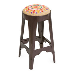 Elisabet Embroidered Stool - The Elisabet Embroidered Stool brings a welcoming touch to a counter or table. Vibrant colors and patterns dance across the jute seat. The homey air of the seat contrasts with the metal frame for an intriguing juxtaposition.
