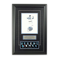 """Heritage Sports Art - Original art of the NFL 1974 Detroit Lions uniform - This beautifully framed piece features an original piece of watercolor artwork glass-framed in an attractive two inch wide black resin frame with a double mat. The outer dimensions of the framed piece are approximately 17"""" wide x 24.5"""" high, although the exact size will vary according to the size of the original piece of art. At the core of the framed piece is the actual piece of original artwork as painted by the artist on textured 100% rag, water-marked watercolor paper. In many cases the original artwork has handwritten notes in pencil from the artist. Simply put, this is beautiful, one-of-a-kind artwork. The outer mat is a rich textured black acid-free mat with a decorative inset white v-groove, while the inner mat is a complimentary colored acid-free mat reflecting one of the team's primary colors. The image of this framed piece shows the mat color that we use (Light Blue). Beneath the artwork is a silver plate with black text describing the original artwork. The text for this piece will read: This original, one-of-a-kind watercolor painting of the 1974 Detroit Lions uniform is the original artwork that was used in the creation of this Detroit Lions uniform evolution print and tens of thousands of other Detroit Lions products that have been sold across North America. This original piece of art was painted by artist Tino Paolini for Maple Leaf Productions Ltd. Beneath the silver plate is a 3"""" x 9"""" reproduction of a well known, best-selling print that celebrates the history of the team. The print beautifully illustrates the chronological evolution of the team's uniform and shows you how the original art was used in the creation of this print. If you look closely, you will see that the print features the actual artwork being offered for sale. The piece is framed with an extremely high quality framing glass. We have used this glass style for many years with excellent results. We package ever"""
