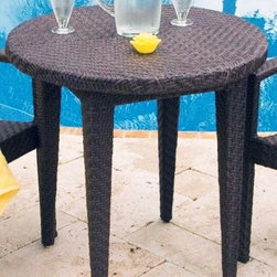 Hospitality Rattan - Soho Patio Woven Dining Table 30 in. Round in - Color shown is not accurate . See additional image as an example of the EXACT product color. This product is warranted for outdoor use. Outdoor wicker dining group. Rehau Fiber java brown finish. Includes woven top. Weather and UV resistant. Plexiglass is used as support underneath wicker weave. Sturdy aluminum legs for extra support. Some assembly required. 30 in. Table: 30 in. W x 30 in. D x 31 in. H (20 lbs.)The Soho Collection is a sleek contemporary collection that offers a unique see-through modular sectional that allows endless possibilities ranging from a sofa, loveseat, armless chair setup, to a standard sectional. The Soho Collection offers a fully anodized aluminum frame, which is then woven with Rehau Java Brown fiber. Its unique look and multi-colored textured surface make it one of the most attractive collections for outdoor use. The Soho Collection only requires cushions for the seating pieces. The balance of the collection can be used without cushions. In addition, glass is optional as the table tops are fully woven and offer reinforced plexiglass undersides for enhanced sturdiness. The large round dining table accommodates an umbrella. The Soho armchair and chaise lounges are all stackable items. The cushions used on the Soho collection are available with synthetic outdoor fabrics including Sunbrella. Most importantly the quality of the Soho collection makes it ideal for contract settings.