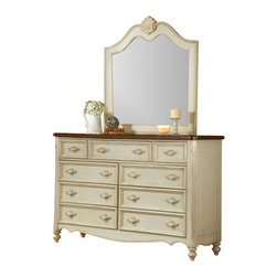 American Woodcrafters - Chateau Triple Dresser and Mirror Set - Dresser. Simulated shell carvings in matching antique white finish. Drawers feature both French and English dovetail. Drawers feature solid wood drawer sides and backs. Large drawers feature double guided metal to metal drawer guides and smaller drawers are center guided.  Both with built in drawer stops to prevent accidental removal. 9 drawers provide abundant storage space. Top three drawers are felt lined to protect your finer things. Drawers are 14.5 in. deep with finished interiors. Antique white with Brown Veneer Tops. Constructed from Mahogany solids and mahogany veneers. No Assembly Required. 19.5 in. D x 66 in. W x 42 in. H ( 173 lbs. )The perfect complement to your traditional French bedroom collection. This dresser from The Chateau Collection is made ofsolid Mahogany, framed with veneers in asoft antique white and sporting a top finished in a warm brown.The piece stands just over 41 in. talland featuresnine drawerswithdovetail joints and double or center guides with positive stops, creating a sturdy, heirloom-quality piece of furniture designed to retain its beauty while withstanding years of wear. Drawers are 14.5 in. deep, and finished inside to prevent snagging. Top drawers include felt liners to protect your fineries.. Mirror. Beveled glass mirror. Mirror supports stained to match the finish. Antique White. Constructed from Mahogany solids and mahogany veneers. No Assembly Required. 2 in. L x 42 in. W x 43 in. H ( 47.2 lbs. )Who's the fairest of them all? Look no further than this landscape mirror, designed to sit atop The Chateau Collection Triple Dresser.This mirror is made of solid Mahogany framed with veneers and accented with decorative moldings, all finished in an elegant and eye-pleasing antique white.Standing just over 43 in. tall, this mirror is made of sturdy beveled glass, which resists chipping and cracking. Its supports are stained to match the finish of the frame.
