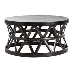 Kathy Kuo Home - Stanley Costello English Modern Bronze Coffee Table - No need to worry about spilling your glass of merlot on this indestructible iron cocktail table, but nevertheless, its beautiful styling will tempt you to treat it like a prized treasure. Crisscrossed bands of bronzed iron merge to create a symmetrical, solid support for the round hammered tabletop above. A perfect fit for your urban modern loft.