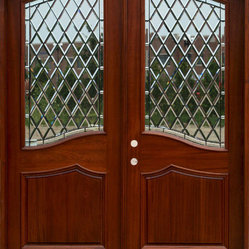The Chateau - This door has the double advantage of a nice wide, substantial profile and wonderful beveled glass to let the light in. It's a great way to add light to the entryway and make a statement.