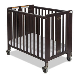 Foundations - Folding Hardwood Compact Crib - HideAway - The crib was manufactured in 2011 or later and complies with the new federal safety standards issued by the CPSC. Made of Hardwood. Includes 2 in. Foam Professional Series mattress which provides superior comfort and is Antimicrobial. 4 in. non-marking, ultra-quiet casters that will maneuver any surface to meet the demands of constant use. Constructed from solid Wood and has a full 1 year warranty. Some assembly required. Sleeping Surface: 24 in. W X 38 in. L. Overall Dimensions: 36.25 in. W x 39.6 in. L x 26 in. H (46 lbs.). Crib Safety: ivgStores cares about the safety of the products we sell especially for your new little one. We work closely with our manufacturers and only carry those items which meet or exceed federal and state laws. If you are considering buying a new crib or even using a previously owned or heirloom crib, we recommend you visit  cribsafety.org to learn more about crib safety.The HideAway crib blends safety, convenience and functionality at an affordable price. Through the door sizing fits through standard doorways in fully assembled position for ease of movement. JPMA certified. Foundations uses only Wood certified to having been harvested with safe and responsible forestry practices and all products comply with the PEFC certification seal.