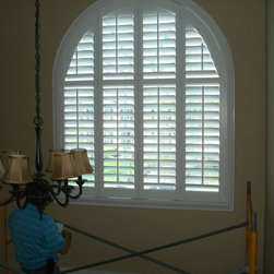 foyer window treatment - Have you ever had one of these foyer windows and not sure how to treat it?  This is a great way to cover with style while protecting the floor and furnishings from uv damage.  The best part about this is at different times of the year you can move the louvers (with a pro pole) depending on how much light you want to let in.  This application is a composite shutter with a real wood frame therefore keeping the cost down.  Prices range from 1500-2500 installed.  Ambiance design is your tall window specialist.  Call us anytime if you need help.