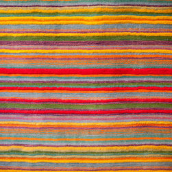Abbey Carpet SF Showroom - Bold striped area rug from our hanging rack.