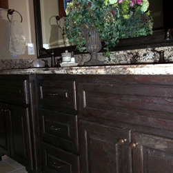 Custom Furniture/Antique refinishing - Custom finish of a transparent crackle over stained wood with a bronze glaze.for guest bath