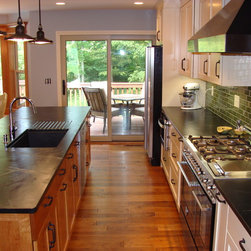 Radcliff, KY - A thoughtful kitchen remodel transformed this Radcliff, Kentucky home. Walls were removed to open up the space. Soapstone countertops by The Stone Studio, Batesville, IN
