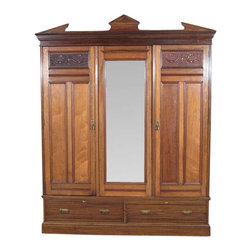 Antiques - Antique English Walnut Sectional Armoire Wardrobe - Country of Origin: England. Circa: 1890. Walnut Construction. Triangular Pediment. Beveled Cornice. 3 Large Doors. 1 Large Beveled Mirror. Paneled Doors. Carved Ornate Designs. Brass Metal Handles. Spacious Closet. Metal Hanging Rod. Linen Lining. Total of 14 Metal Hooks. Rectangular Beveled Designs. Total of 8 Drawers. Dovetail Joinery. Strong & Sturdy. Excellent Quality! It Comes in 5 Pieces. This is a large and gorgeous antique English walnut 3 door sectional armoire wardrobe closet. It has a distinguished triangular pediment with a traditional beveled cornice and it features a large wardrobe that includes a spacious lined shelf on top with 3 metal hooks, 2 top open drawers, 4 traditional smooth operating drawers with dovetail joinery that have lovely metal handles, a large lined closet  that has 6 metal hooks and a convenient metal hanging rod. The lining has some age appropriate wear and tear but it can be easily replaced if necessary. They have 3 large doors; 2 of them are paneled and have elegant raised beveled rectangular surfaces with fancy decorative carved designs on top and lovely brass handles, and the other door includes a large luxurious beveled mirror. The mirror  may have some age appropriate hazing but it is not distracting at all and it validates its antiquity, circa 1890! In addition there are 2 smooth operating drawers on the bottom with dovetail joinery that have traditional facings with fancy brass handles. This piece may show minor age appropriate signs of wear including minor wood imperfections but as shown it is overall in very good cosmetic and structural condition for its age and it is strong and sturdy.  This is a high end armoire with excellent quality! From the elegant design to quality build this piece of furniture will bring many years of convenience and pleasure to your home.