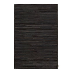 Nourison - Calvin Klein Home Prairie Modern Marble Pile Print Black 8' x 10' Cowhide Rug by - This collection of special skin rugs brings the beauty of nature inside.The cowhides' contrasting hues and alternating hair direction add to the design and sophistication of this unique all natural collection. This is an all natural animal skin product that with regular wear will change in look over time. This product is not recommended for high traffic areas such as dining rooms, and special care should be exercised when moving furniture.