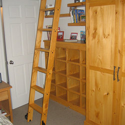 Rolling Library Ladders - The Quiet Glide rolling ladder is a classy way to add functionality to your library, closet, wine cellar, kitchens, pantries, or lofts; anywhere you want to reach those out-of-the-way places.