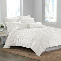Dkny - DKNY Ruffle Wave Twin Duvet Cover in White - Create a gorgeous focal point for your bedroom with the Ruffle Wave duvet cover. Luxurious rows of ruffles dance upon this soft and eye-catching bedding, creating textural interest and dimension that will revitalize the look of your décor.