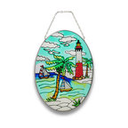 Zeckos - Nautical Sailboat, Beach, and Lighthouse Oval Glass Suncatcher 9 In. - This nautical sun catcher adds a colorful accent to any window, featuring a lighthouse on the beach, palm trees, and 2 sailboats. The palm fronds have a crystallized texture, adding some depth to the piece. The sun catcher measures 9 inches tall, 7 inches wide, and has a 2 inch drop from the chrome chain hanger. It makes a great gift for friends and family that is sure to be admired.