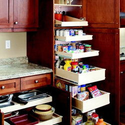 Pull Out Pantry Shelves - Outfit your pantry and your kitchen cabinets with pull out shelves from ShelfGenie and increase your usable storage space.  The pantry features a tray divider on the top shelf, with a sloped shelf below.  The sloped shelf provides extra stability in the back while providing unhampered access in the front of the shelf.  The next two shelves are single-height, and the three bottom shelves are double-height shelves.