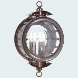 Troy Lighting - Charleston Outdoor Wall Mount by Troy Lighting - Whether the night is stormy or clear, the Troy Lighting Charleston Outdoor Wall Mount will point the way home every time. Its nautical sensibility is inspired in part by the shape of a seaman's compass. The circular frame is made out of solid brass and finished in a rich Heritage Bronze, while panels of Antique Clear glass along the front and sides create a watertight shade. Available in two sizes. Troy Lighting, headquartered in California, designs and manufactures indoor and outdoor lighting fixtures, utilizing hand-forged iron and hand-applied finishes to create quality products with high-style appeal.