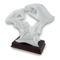 "Zeckos - ""With This Ring"" Glossy White Finish Wedding Hands Statue - This glossy white finished statue features a pair of hands atop roses, one hand placing a wedding ring on the ring finger of the other hand. The statue measures 8 1/4 inches high, 9 inches across, and 3 5/8 inches deep. Made of cold cast resin, it is hand finished with glossy white enamel to give it the look of ceramic. The base is mahogany enamel to give the appearance of real wood. Celebrate your moment or help friends celebrate theirs. It would also make a lovely memorial gift."