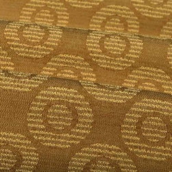 Agra Geometric Upholstery Fabric in Allspice - Agra Geometric Upholstery Fabric in Allspice is a golden, textured fabric with a modern circular pattern. The stain repellent finish makes this the perfect fit for high-traffic areas. American made from a blend of 81% polyester and 19% cotton. Exceeds Wyzenbeek 50,000 double rubs. Passes CA Bulletin #117; NFPA 260, UFAC Class I. Cleaning Code: S. Repeat: 11″ V 5.25″ H; Width: 52″ 16 oz/linear yd.