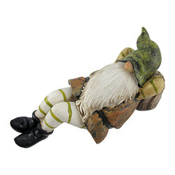 Dozing Dwarf Garden Gnome Figurine - This darling dozing dwarf is the perfect addition to your flower bed or garden- he`s catching some ZZZs, resting on a tree stump, enjoying the great outdoors. Made of cold cast resin and hand painted, this piece measures 9 1/2 inches long, 4 3/4 inches tall, and 4 1/2 inches wide. It makes a great addition to an existing garden gnome collection, or a good start of a collection for a new homeowner.