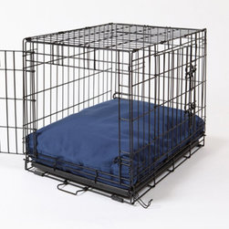 Crate Covers & More - Rectangular Dog Bed & Bed Cover - Sailors Blue - RECSAILDOG22 - Shop for Accessories and Parts from Hayneedle.com! The Rectangular Dog Bed & Bed Cover - Sailors Blue is a handsome navy blue dog bed perfect for your pup. This set includes a comfortable waterproof hypo-allergenic polyfill dog bed and a super soft navy blue 200 denier nylon bed cover. Maybe best of all the whole thing is easy to wash. Simply unzip and toss the cover into the washing machine and hand-wash and air-dry the dog bed. It comes in several sizes to fit your dog crate (dog crate not included shown for scale). Sizes: (each size includes white pillow dog bed and sailors blue washable cover) X-Small: Fits crates 14W x 22D inches Small: Fits crates 21W x 25D inches Medium: Fits crates 21W x 30D inches Large: Fits crates 24W x 36D inches X-Large: Fits crates 28W x 42D inches XX-Large: Fits crates 30W x 48D inches About Crate Covers and MoreCrate Covers and More provides stylish dog crate covers dog bed covers and sofa covers. These covers allow dog owners to make their dog more comfortable while enhancing their home decor. Dogs feel safe and protected when their kennel or crate is covered which means they won't bark. When your dog's crate is covered you get to enjoy your pup as well as your choice of a wide variety of contemporary color and pattern options. Dog trainers recommend Crate Covers and More items because they make kennel training easier. All Crate Covers and More covers are made of high quality fabrics in America.