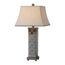 Uttermost - Mincio Ceramic Table Lamp - In your living room, this lamp will be a standout. Giving a nod to your traditional style, this textured ceramic lamp is finished in a dark blue glaze with bronze highlights. A pair of these flanking your sofa or on your console table will add style and glamour.