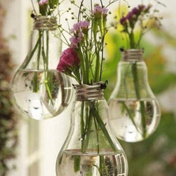 Vintage Vase From Recycled Lightbulb by Exclusive Design Art - Vintage lightbulbs from the Soviet Union are an ecofriendly and charming way to display blooms.