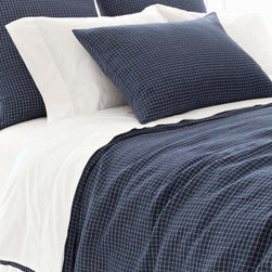 Parchment Linen Checkerboard Ink Duvet Cover - Be bold and graphic but classically approachable with a tailored linen duvet cover in a simple, striking low-key pattern.  The Parchment Linen Checkerboard Ink Duvet Cover uses a sharp indigo as its base color, but adds a small-scale ivory grid pattern that looks perfect in simple, masculine spaces � while also offering a high-impact base element for eclectic, colorful layering.