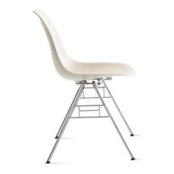 Herman Miller - Eames Molded Plastic Stacking Side Chair - The work of Charles and Ray Eames, the Molded Plastic Chair (1948) was the first industrially manufactured plastic chair. In creating this classic piece, the Eameses honed two techniques with which they had been grappling for years: the use of a bent and welded wire base and an organically shaped plastic shell seat. The results are supremely comfortable and timeless. This original is an authentic, fully licensed product of Herman MillerÆ, Inc. EamesÆ is a licensed trademark of Herman Miller. Made in U.S.A. The DSS (dining height, side chair shell, stacking base) can be ganged together and stacks up to 14 high. Molded shell seat has a high, flexible back and a deep seat pocket. The waterfall seat edge keeps you comfortable for extended periods of time by reducing pressure on the backs of thighs. The colors Wafer and Aqua Sky were inspired by the Eameses' original color palette. Originally made with fiberglass-reinforced plastic, these chairs are now composed of more eco-friendly polypropylene. Contract quality.