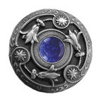 "Inviting Home - Jeweled Lily Knob (antique pewter with blue sodalite) - Jeweled Lily Knob in antique pewter with blue sodalite semi-precious stone 1-3/8"" diameter Product Specification: Made in the USA. Fine-art foundry hand-pours and hand finished hardware knobs and pulls using Old World methods. Lifetime guaranteed against flaws in craftsmanship. Exceptional clarity of details and depth of relief. All knobs and pulls are hand cast from solid fine pewter or solid bronze. The term antique refers to special methods of treating metal so there is contrast between relief and recessed areas. Knobs and Pulls are lacquered to protect the finish. Alternate finishes are available. Blue Sodalite Semi-Precious stone. Blue Sodalite is a royal blue colored stone that usually has some white or gray-colored streaks. Blue Sodalite looks a bit more crystal-like. It was named by Professor Thomas Thompson who was called in to identify the specimen that was brought from Greenland to Denmark during the time of the Napoleonic wars - he identified it at first as Sodium Aluminum Silicate Chloride. The stone is associated with the Astrological sign Sagittarius and is thought to promote focus clearing mediation and calming of fears."