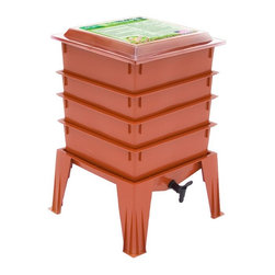 The Worm Factory - The Worm Factory 360 Worm Composter - Terra Cotta Multicolor - WF360-TERRA CO - Shop for Hose Reels and Organizers from Hayneedle.com! Additional features: Odorless operation with Thermo Siphon Airflow design Recycles kitchen waste and junk mail into compost Use indoors during winter and outdoors in summer Improved lid and base design Holds up to 8 trays - largest worm composter of its kind 20-year warranty on parts and workmanship While it's similar in design to the popular Worm Factory 4-Tray Composter (CAD002) The Worm Factory 360 Worm Composter - Terra Cotta features a thicker sturdier design with an improved base and lid. And the new Terra Cotta color looks great in any outdoor setting. This composter can hold up to 8 trays instead of 7 and it includes a handy compost accessory kit featuring a coir brick hand rake scraper and thermometer which make maintaining your system cleaner and easier. It even comes with an instruction video that's great for beginners. The Worm Factory 360 composter also features new Thermo Siphon Airflow design which allows air to enter on all four sides of the base exposing the bottom tray to an endless supply of fresh air without allowing light inside. The lids is also vented on all four sides which allows the heat and gases generated during composting to continually escape through the top. Ideal composting conditions occur at temperatures between 45 and 85 degrees Fahrenheit. We suggest using your composter outdoors during the summer and indoors during the winter to maximize efficiency. At capacity this composter can house over 6 000 worms which can consume 5-8 lbs. of food and paper waste per week. Purchase includes: Base 4 stacking trays Worm tea collection tray Spigot Lid Coir Brick Assembly screws Hand rack Scraper Thermometer Instruction book Instruction video What is The Worm Factory 360 and how does it work?The Worm Factory is a multi-tray worm composter that helps manage the composting process. Fill each sta