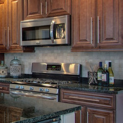 Chocolate color maple kitchen - Full line of Raised Panel kitchen Cabinets and Vanities with a large selection of Accessories finished in a Chocolate color