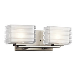 """Kichler - Contemporary Kichler Bazely 15"""" Wide High Mitered Glass Bath Light - Two stunning thick-ribbed mitered glass cubes sit atop a metal frame in this contemporary brushed nickel bath light. The satin etched interior of the glass highlights the exquisite attention to detail of this 2-light fixture. A beautiful transitional home accent from Kichler lighting. Transitional 2-light bathroom fixture. Brushed nickel finish. Metal frame and wall plate. Thick-rib press mitered glass with satin etched interior. Includes two 50 watt G9 bulbs. UL-rated for damp locations. 5"""" high. 15"""" wide. Extends 4 1/2"""". Back plate is 7"""" wide and 4 1/2"""" high.   Transitional 2-light bathroom fixture.  Brushed nickel finish.  Metal frame and wall plate.  Thick-rib press mitered glass with satin etched interior.  Includes two 50 watt G9 bulbs.  UL-rated for damp locations.  5"""" high.  15"""" wide.  Extends 4 1/2"""".  Back plate is 7"""" wide and 4 1/2"""" high."""